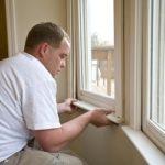 Carpenter repairing window frames